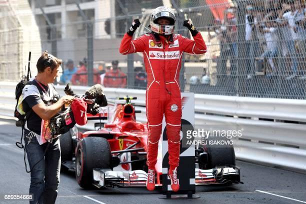 TOPSHOT Ferrari's German driver Sebastian Vettel celebrates as he leaves his car after winning the Monaco Formula 1 Grand Prix at the Monaco street...