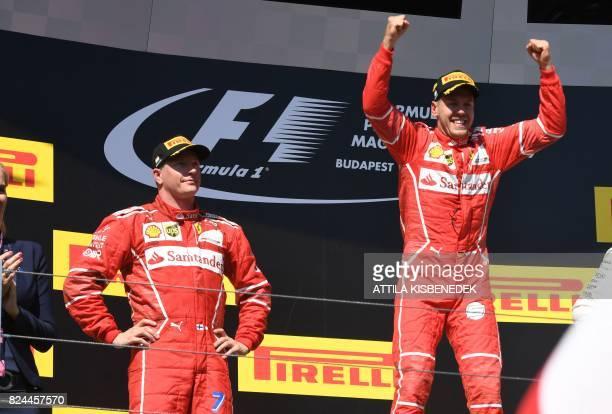 Ferrari's German driver Sebastian Vettel celebrates at the Hungaroring racing circuit in Budapest on July 30 after winning the Formula One Hungarian...