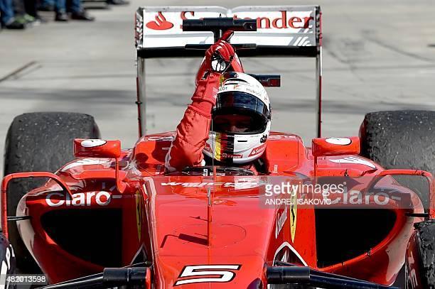 Ferrari's German driver Sebastian Vettel celebrates winning the Hungarian Formula One Grand Prix at the Hungaroring circuit near Budapest on July 26...