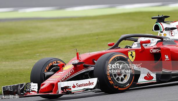 Ferrari's German driver Sebastian Vettel drives during a practice session at Silverstone motor racing circuit in Silverstone central England on July...
