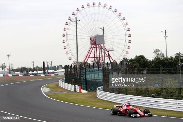 TOPSHOT Ferrari's German driver Sebastian Vettel drives during the first practice round of the Formula One Japanese Grand Prix at Suzuka on October 6...