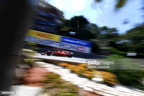 Ferrari's German driver Sebastian Vettel drives during the Monaco Formula 1 Grand Prix at the Monaco street circuit on May 28 2017 in Monaco / AFP...