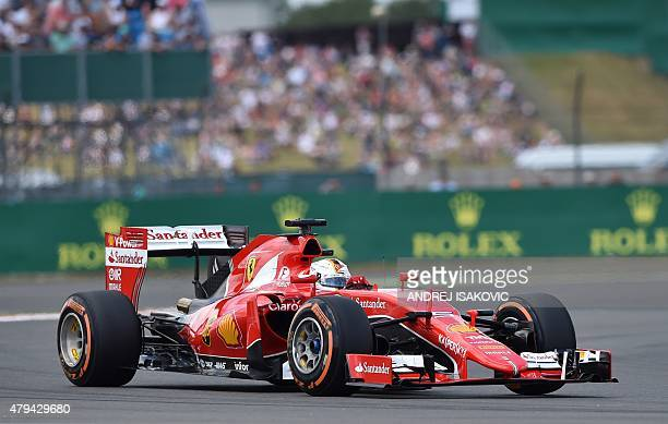 Ferrari's German driver Sebastian Vettel drives during the qualifying session at the Silverstone circuit in Silverstone on July 4 2015 ahead of the...