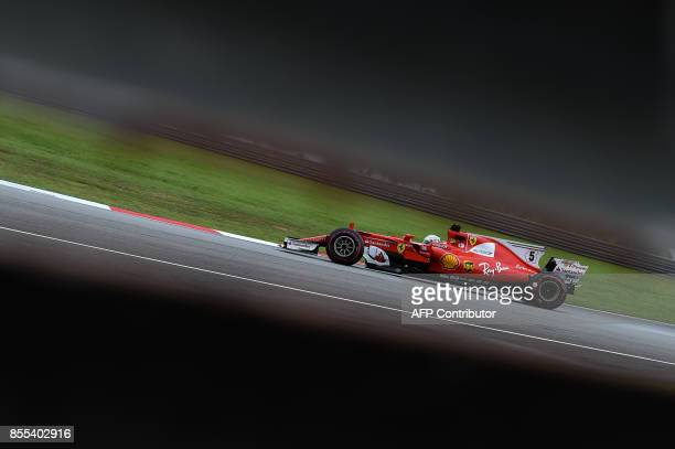 TOPSHOT Ferrari's German driver Sebastian Vettel drives during the second practice session of the Formula One Malaysia Grand Prix in Sepang on...