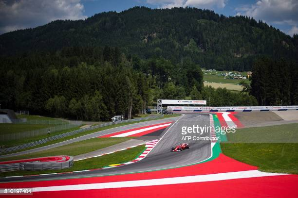 TOPSHOT Ferrari's German driver Sebastian Vettel drives his car during the first practice session of the Formula One Austria Grand Prix at the Red...
