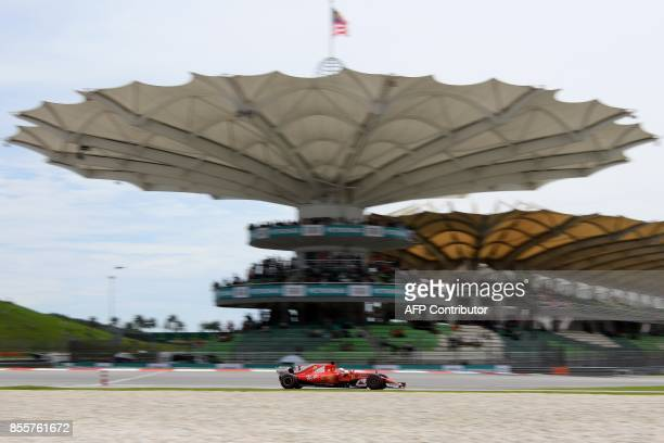 Ferrari's German driver Sebastian Vettel drives his car during the third practice session of the Formula One Malaysia Grand Prix in Sepang on...