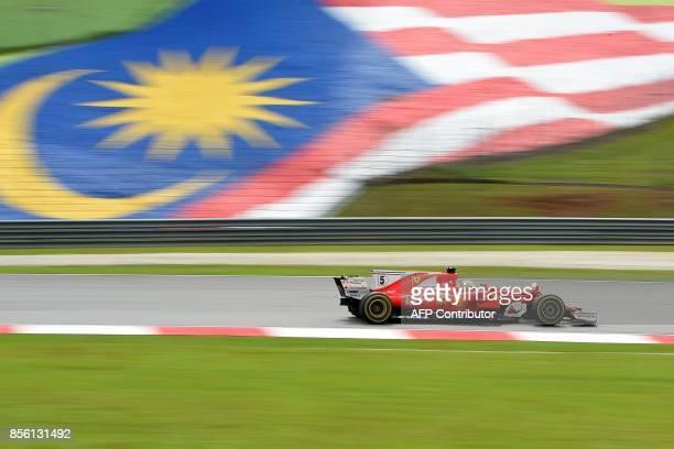 Ferrari's German driver Sebastian Vettel drives his car during the Formula One Malaysia Grand Prix in Sepang on October 1 2017 / AFP PHOTO / MANAN...