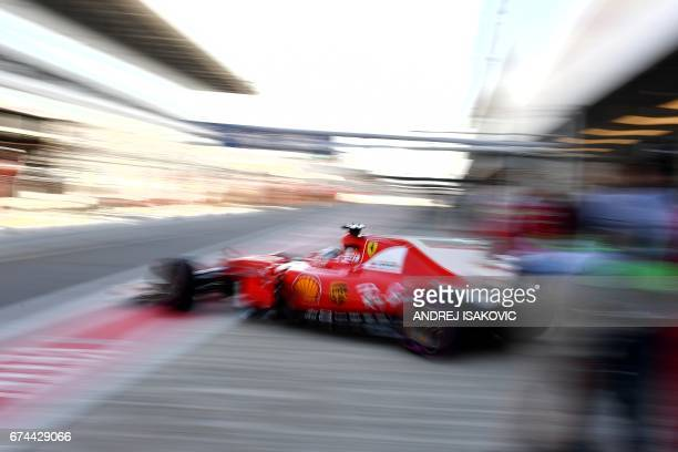 TOPSHOT Ferrari's German driver Sebastian Vettel leaves the pits during the second practice session of the Formula One Russian Grand Prix at the...