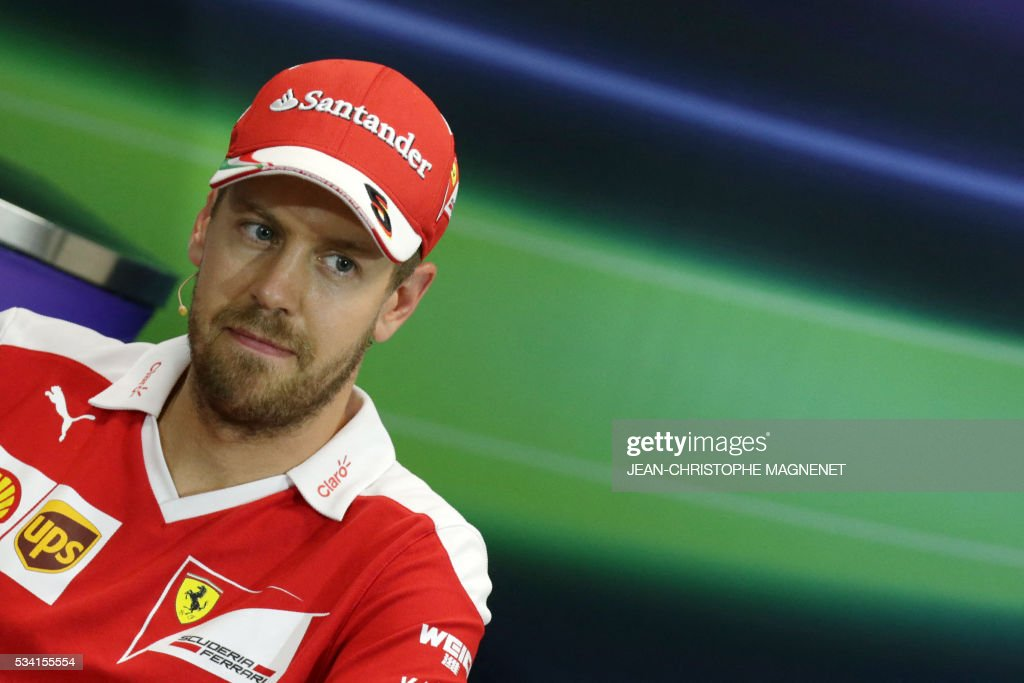 Ferrari's German driver Sebastian Vettel looks on during a press conference at the Monaco street circuit in Monte-Carlo on May 25, 2016, four days ahead of the Monaco Formula One Grand Prix. / AFP / Jean-Christophe MAGNENET