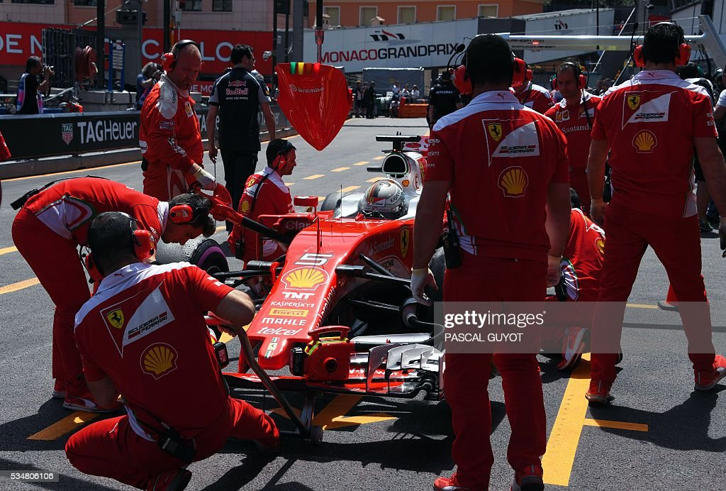 Ferrari's German driver Sebastian Vettel pit stops during the third practice session at the Monaco street circuit, on May 28, 2016 in Monaco, one day ahead of the Monaco Formula 1 Grand Prix. / AFP / PASCAL