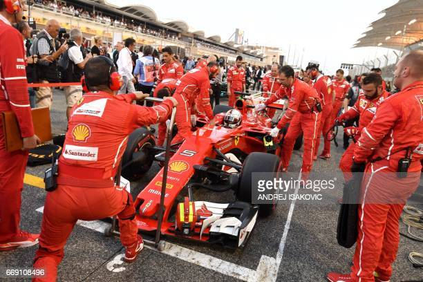 Ferrari's German driver Sebastian Vettel prepares on the strating grid aheahd of during the Bahrain Formula One Grand Prix at the Sakhir circuit in...