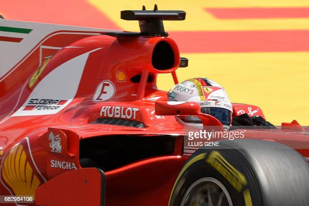 Ferrari's German driver Sebastian Vettel races at the Circuit de Catalunya on May 14 2017 in Montmelo on the outskirts of Barcelona during the...
