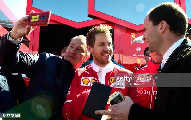 Ferrari's German driver Sebastian Vettel signs autographs at the Circuit de Catalunya on March 1 2017 in Montmelo on the outskirts of Barcelona...