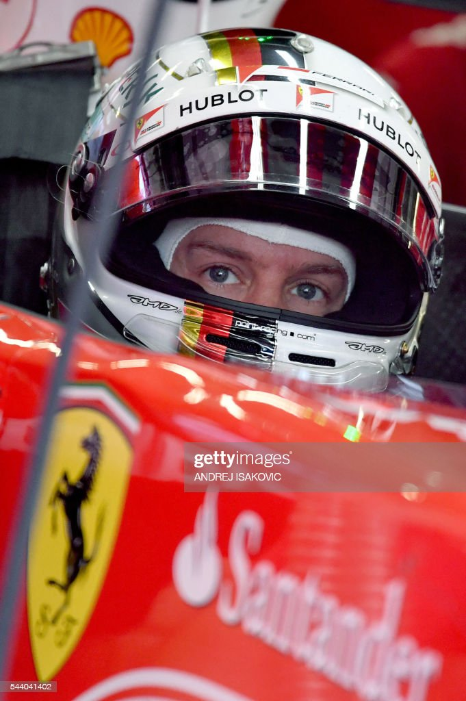 Ferrari's German driver Sebastian Vettel sits in his car ahead of the first practice session of the Formula One Grand Prix of Austria at the Red Bull Ring in Spielberg, Austria on July 1, 2016. / AFP / ANDREJ