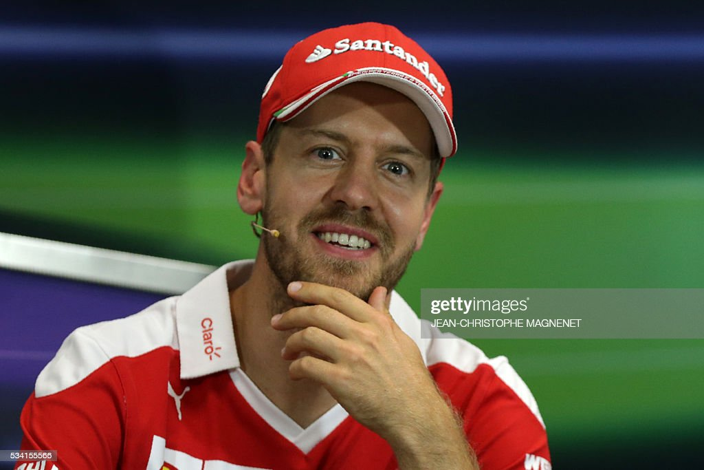 Ferrari's German driver Sebastian Vettel smiles during a press conference at the Monaco street circuit in Monte-Carlo on May 25, 2016, four days ahead of the Monaco Formula One Grand Prix. / AFP / Jean-Christophe MAGNENET