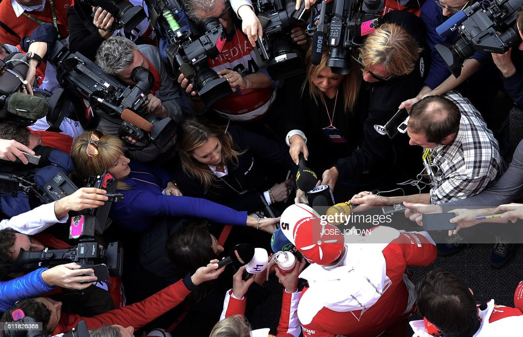 TOPSHOT Ferrari's German driver Sebastian Vettel speaks to the press at the Circuit de Catalunya on February 23 2016 in Montmelo on the outskirts of...