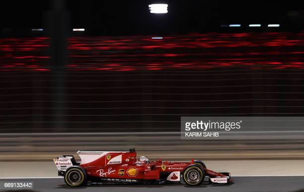 Ferrari's German driver Sebastian Vettel steers his car during the Bahrain Formula One Grand Prix at the Sakhir circuit in Manama on April 16 2017...