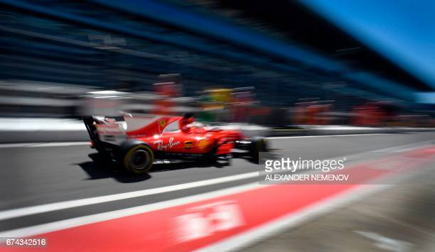 TOPSHOT Ferrari's German driver Sebastian Vettel steers his car during the first practice session of the Formula One Russian Grand Prix at the Sochi...