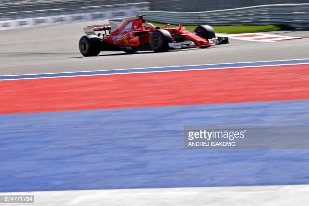 TOPSHOT Ferrari's German driver Sebastian Vettel steers his car during the qualifying session for the Formula One Russian Grand Prix at the Sochi...