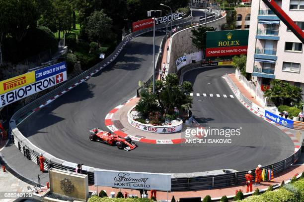 TOPSHOT Ferrari's German driver Sebastian Vettel steers his car during the second practice session at the Monaco street circuit on May 25 2017 in...