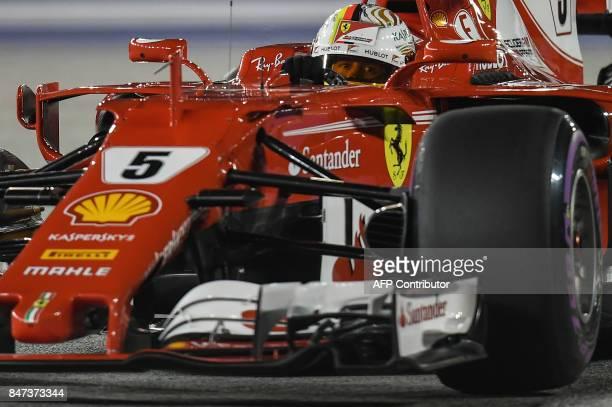 Ferrari's German driver Sebastian Vettel takes a corner during the second practice session of the Formula One Singapore Grand Prix in Singapore on...