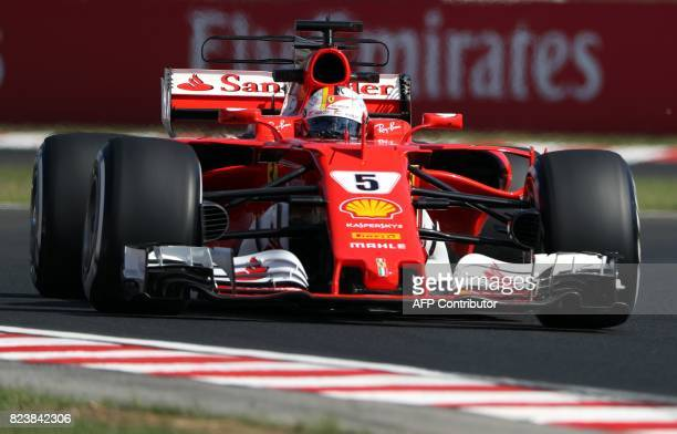 Ferrari's German driver Sebastian Vettel takes part in a practice session at the Hungaroring racing circuit in Budapest on July 28 2017 prior to the...