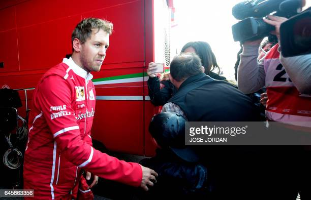 Ferrari's German driver Sebastian Vettel walks at the Circuit de Catalunya on February 27 2017 in Montmelo on the outskirts of Barcelona during the...