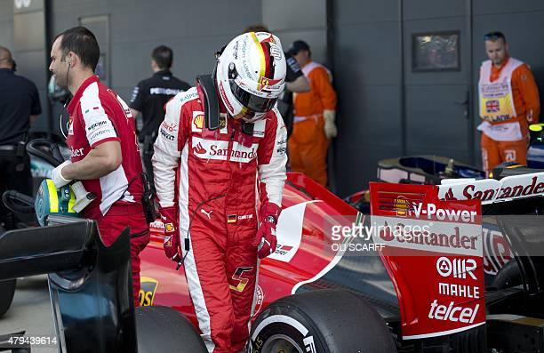 Ferrari's German driver Sebastian Vettel walks from his car after the qualifying session at the Silverstone circuit in Silverstone on July 4 2015...