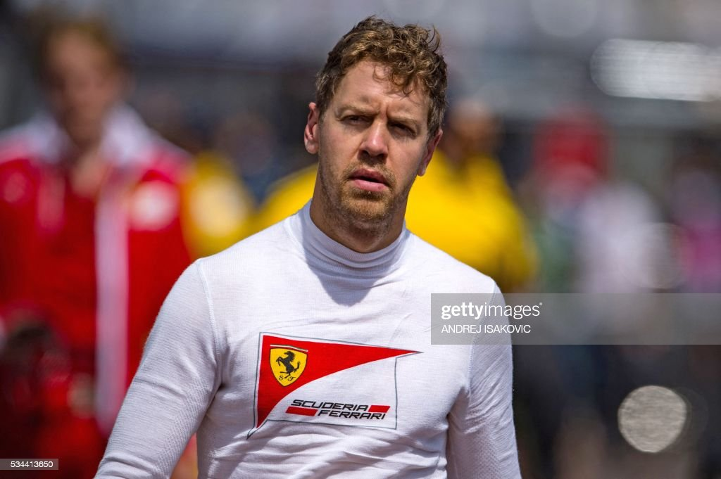 Ferrari's German driver Sebastian Vettel walks in the paddock during the first practice session at the Monaco street circuit, on May 26, 2016 in Monaco, three days ahead of the Monaco Formula 1 Grand Prix. / AFP / ANDREJ