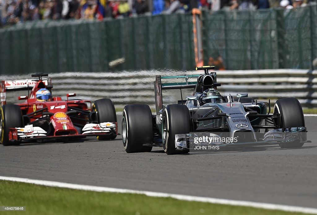 Ferrari's Spanish driver Fernando Alonso and Mercedes-AMG's German driver Nico Rosberg drive at the Spa-Francorchamps ciruit in Spa on August 24, 2014 during the Belgium Formula One Grand Prix.