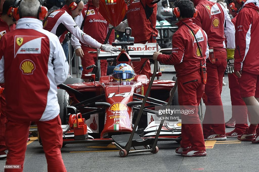 Ferrari's Spanish driver Fernando Alonso arrives in the pits during the second practice session at the Spa-Francorchamps circuit in Spa on August 22, 2014 ahead of the Belgium Formula One Grand Prix. AFP PHOTO / JOHN THYS
