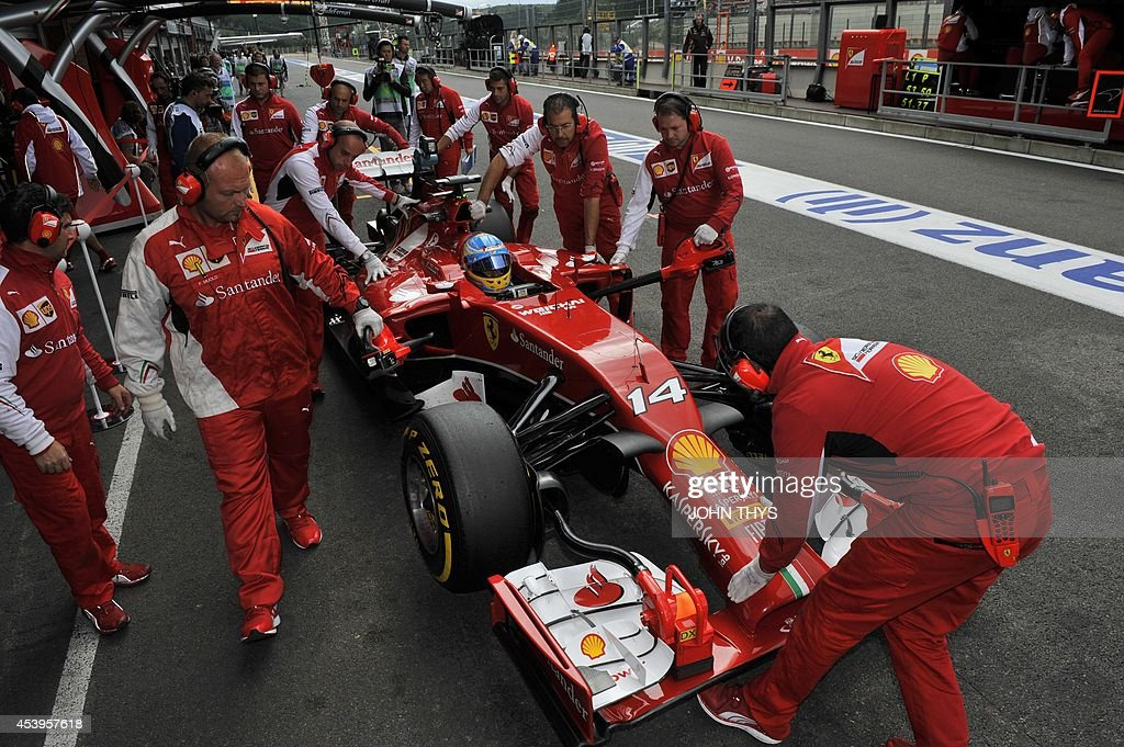 Ferrari's Spanish driver Fernando Alonso arrives in the pits during the second practice session at the Spa-Francorchamps circuit in Spa on August 22, 2014 ahead of the Belgium Formula One Grand Prix.