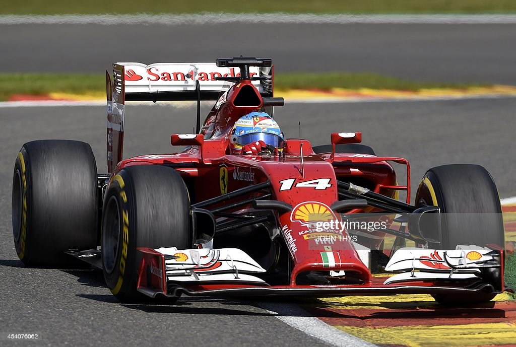 Ferrari's Spanish driver Fernando Alonso drives at the Spa-Francorchamps ciruit in Spa on August 24, 2014 during the Belgium Formula One Grand Prix. AFP PHOTO / JOHN THYS