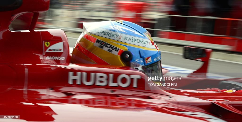 Ferrari's Spanish driver Fernando Alonso leaves the pits during the first practice session at the Spa-Francorchamps circuit in Spa on August 22, 2014 ahead of the Belgium Formula One Grand Prix.