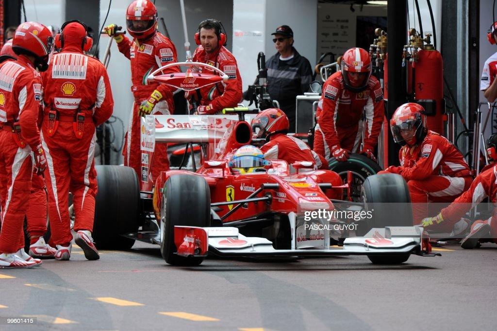 Ferrari's Spanish driver Fernando Alonso pit stops at the Monaco street circuit on May 16, 2010, during the Monaco Formula One Grand Prix.