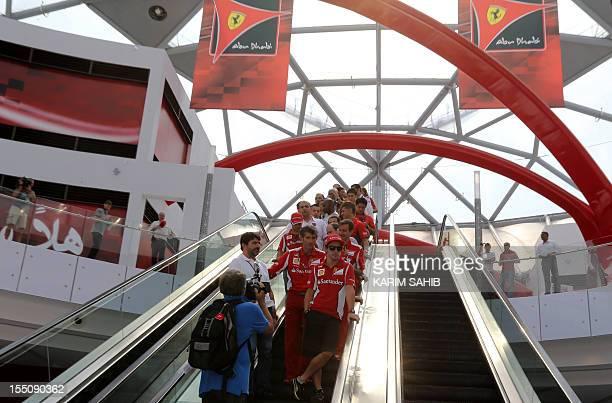 Ferrari's Spanish driver Fernando Alonso stands on an escalator during a visit to Ferrari World near the Yas Marina circuit on November 1 2012 in Abu...