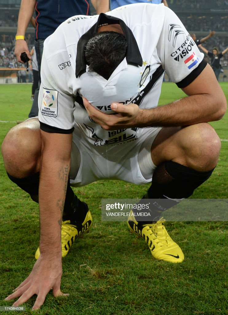 Ferreira of Paraguayan Olimpia reacts after losing their Libertadores Cup second leg final football match shoot-out against Brazilian Atletico Mineiro at the Mineirao stadium in Belo Horizonte, Brazil on July 24, 2013. Atletico Mineiro won by 4-3 after a penalty shoot-out. AFP PHOTO / VANDERLEI ALMEIDA