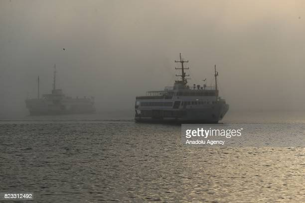 Ferries are seen during the heavy mist in Istanbul Turkey on July 27 2017
