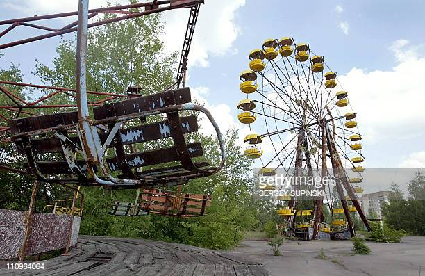 A ferris wheel and a carousel are abandoned 26 May 2003 in the amusement park of the ghost town of Prypyat adjacent to the Chernobyl nuclear plant...