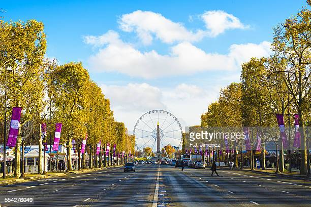 Ferris wheel and Luxor Obelisk from Champs Elysees