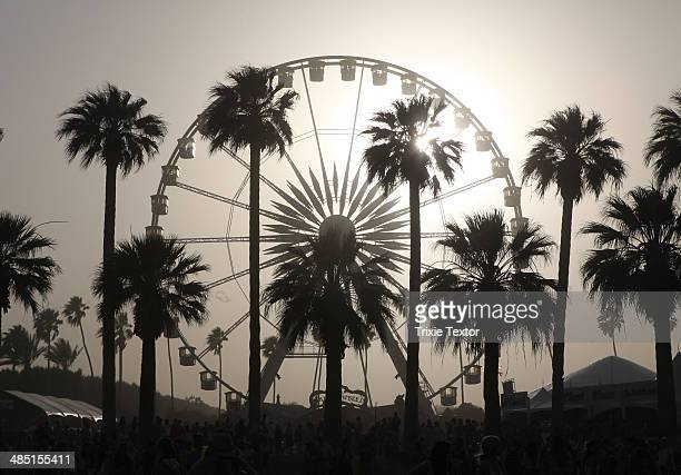 Ferris wheel and palm trees are seen during day 2 of the 2014 Coachella Valley Music Arts Festival at the Empire Polo Club on April 12 2014 in Indio...