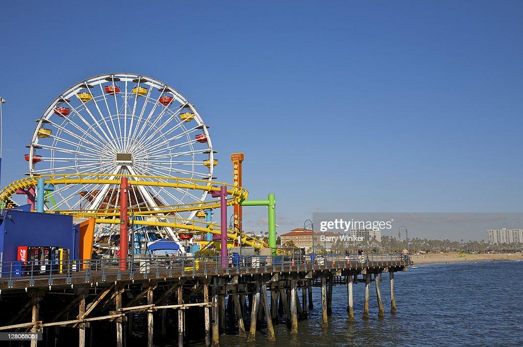 Ferris wheel and rides at Pacific Park at Santa Monica Pier, Los Angeles, California, USA, May 2010