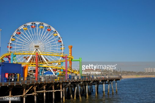 Ferris wheel and rides at Pacific Park at Santa Monica Pier, Los Angeles, California, USA, May 2010