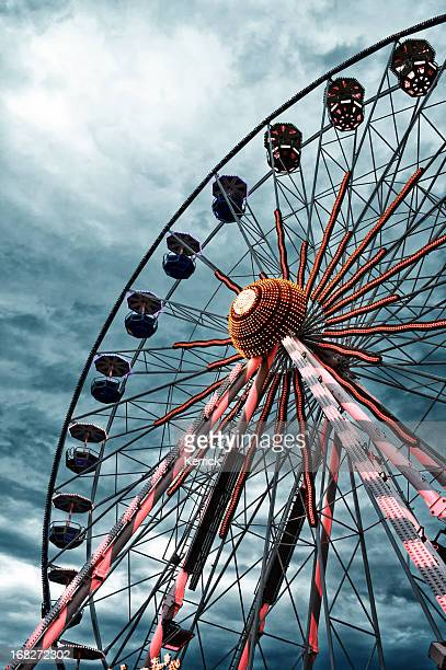 Ferris wheel in front of dramatic sky