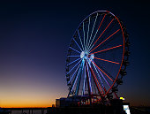 ferris wheel lit up red, white and blue