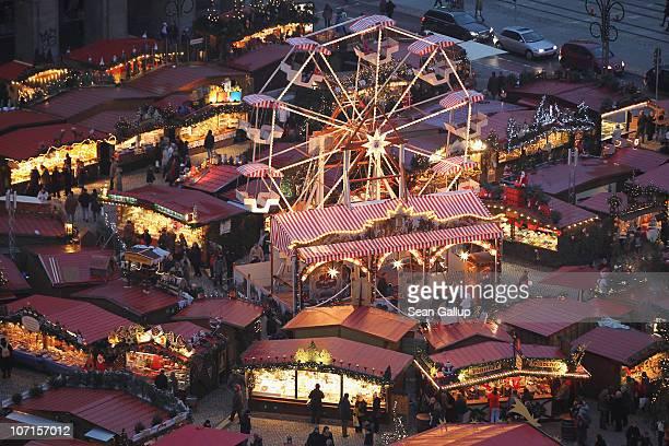 A ferris wheel turns at the Dresdner Striezelmarkt Christmas market on November 26 2010 in Dresden Germany The Striezelmarkt claims to be Germany's...