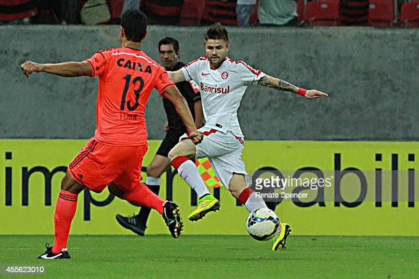 Ferron of Sport Recife battles for the ball with Sasha of Internacional during the Brasileirao Series A 2014 match between Sport Recife and...