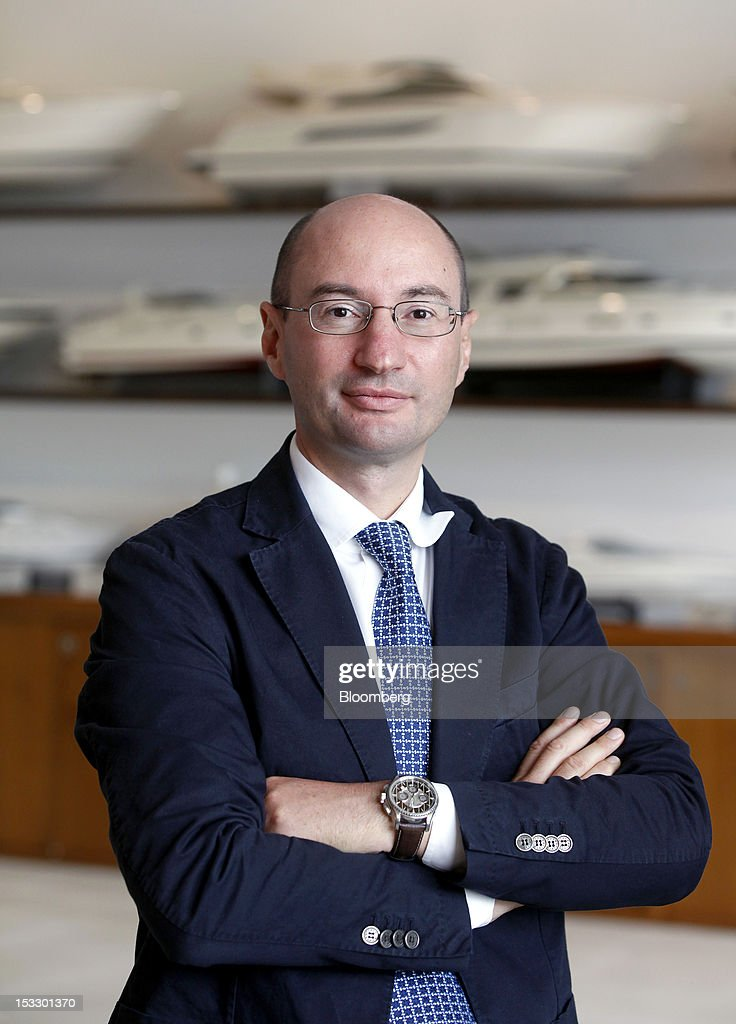 Ferruccio Rossi, chief executive officer of Ferretti Group's Riva boat unit, poses for a photograph in the company's offices in Sarnico, Italy, on Tuesday, Oct. 2, 2012. Ferretti Group, whose Riva unit made boats for Brigitte Bardot and Sean Connery, intends to open an assembly plant in China as its new Chinese parent, Shandong Heavy, seeks to drive up sales in the world's most-populous country. Photographer: Alessia Pierdomenico/Bloomberg via Getty Images