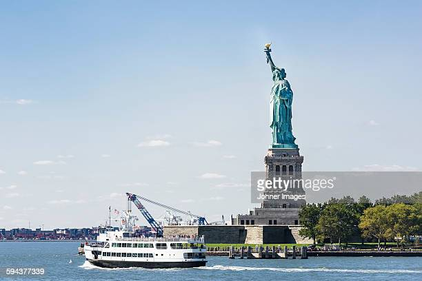 Ferry and Statue of Liberty, New York City, USA