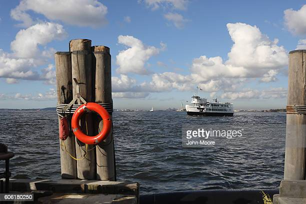 A ferry arrives to take immigrants to Ellis Island for a naturalization ceremony on September 16 2016 in New York City The ceremony marked US...